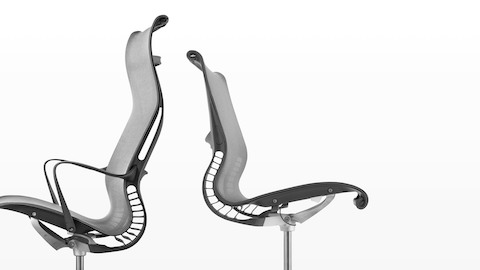 Profile view of two light gray Setu office chairs, showing flexible back support.