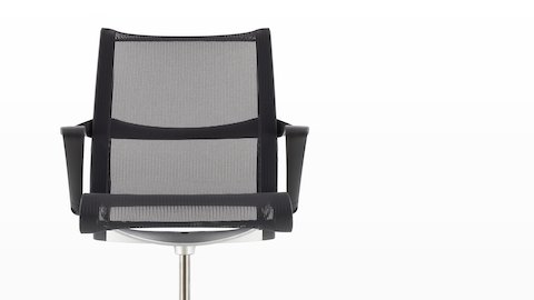 Close-up of the elastic seat and back on a black Setu office chair.