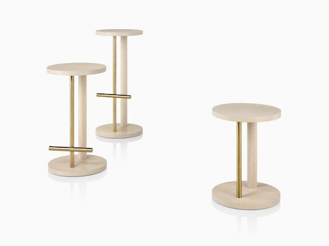 Family of Spot Stools in white ash with brass finish, viewed at an angle.