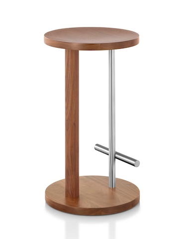 Angled view of a medium-height Spot Stool with a medium wood finish and silver crossbar footrest.
