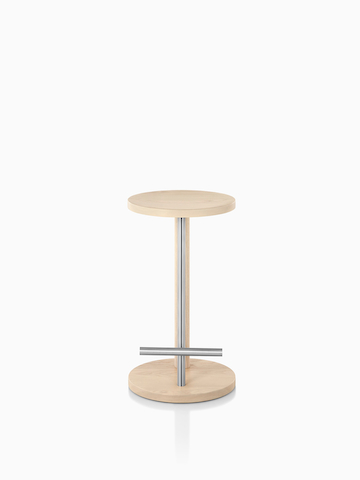 Spot Stool With A Light Wood Finish.