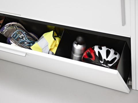 Personal items inside the open drawer of a Stem storage unit.