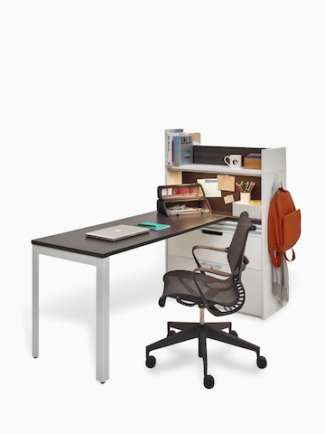 A Stem workstation with a storage unit, peninsula desk, and Setu office chair. Select to go to the Stem product page.