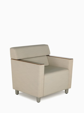 A beige Steps Lounge System chair with wood arm caps. Select to go to the Steps Lounge System product page.