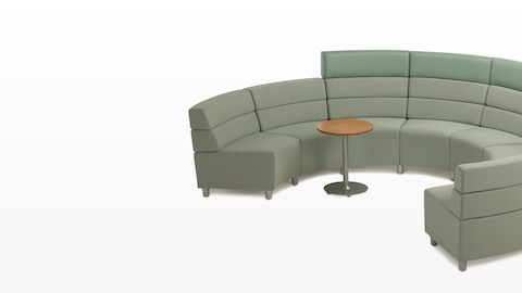 A semicircular Steps Lounge System configuration combining mid- and high-back seating modules in green upholstery.