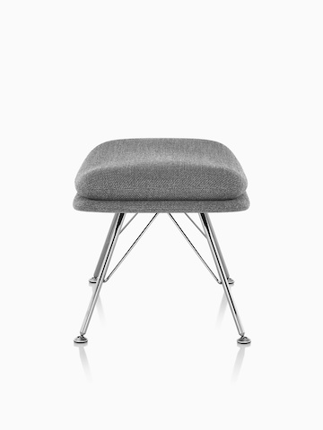 Side view of Striad Ottoman in gray upholstery with wire base.