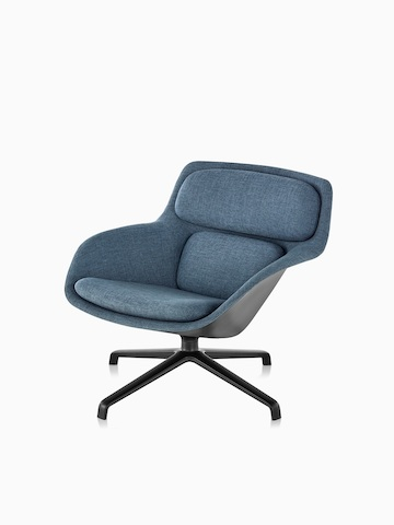 Three-quarter view of low-back Striad Lounge Chair in blue upholstery with four-star base.