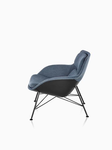 Side view of low-back Striad Lounge Chair in blue upholstery with wire base.