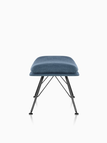 Side view of Striad Ottoman in blue upholstery with wire base.
