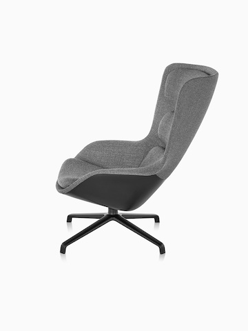 Side view of high-back Striad Lounge Chair in gray upholstery with four-star base.