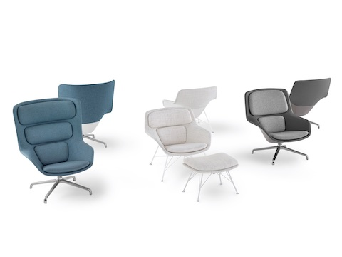 A group of Striad Lounge Chairs with matching Otomans in a variety of heights and upholstery textiles.