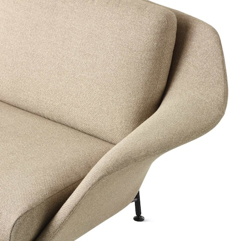 A detail image of a Striad Low-Back Sofa with Three-Seats in tan.