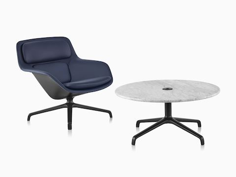 Navy leather Striad Low-Back Lounge Chair with Striad Table with Carrara marble surface.