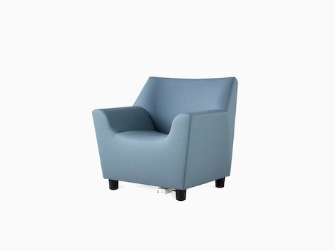 A Swoop Club Chair and ottoman in a blue upholstery. The Swoop Club Chair has an optional power unit and housing.