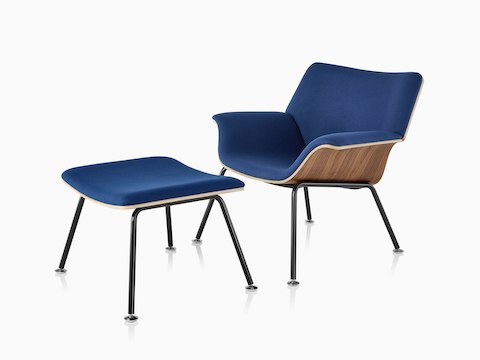 Swoop Plywood Lounge Chair and Ottoman with dark royal blue upholstery viewed from a 45-degree angle