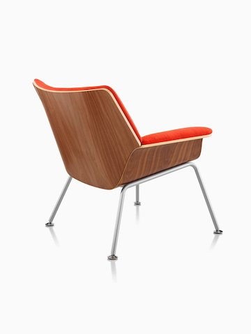 Three-quarter rear view of a Swoop Plywood Lounge Chair with red upholstery.