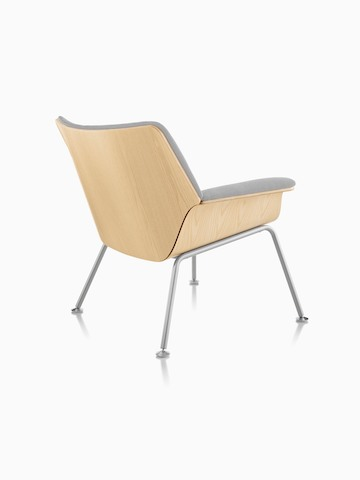 Three-quarter rear view of a Swoop plywood lounge chair with gray upholstery.