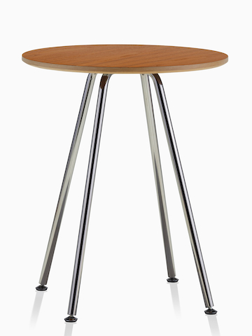 A round Swoop table with a medium wood finish. Select to go to the Swoop Lounge Furniture product page.