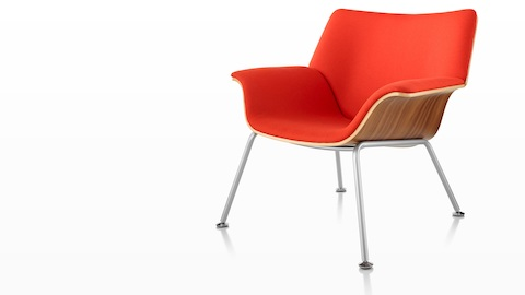 Swoop plywood lounge chair with red upholstery, viewed from a 45-degree angle.