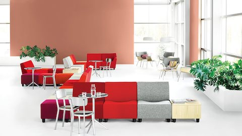 Gathering space featuring Swoop Lounge Furniture, both modular seating components and lounge chairs.
