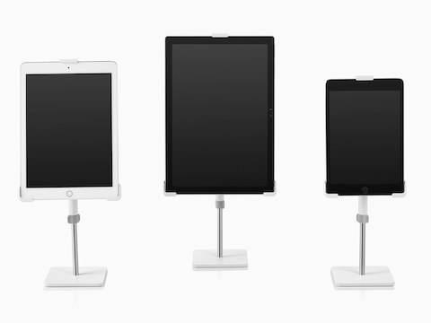 Three freestanding Tabetha Tablet Mounts holding tablet computers of various sizes.