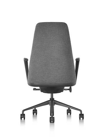 Profile view of a black fabric Taper executive chair.