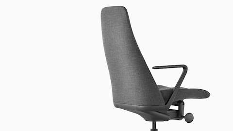 Three-quarter rear view of a Taper executive chair in gray fabric, showing contoured backrest.
