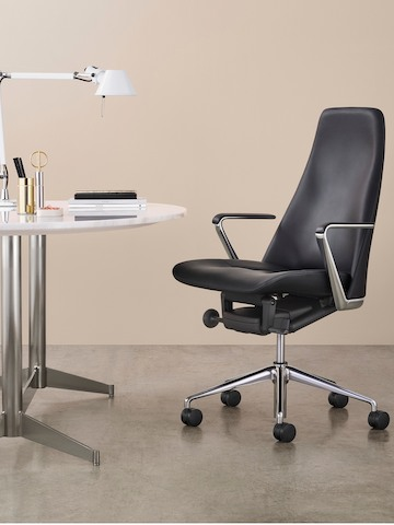Black leather Taper executive chair in a contemporary private office.