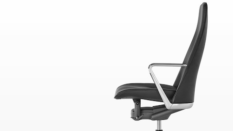 Profile view of a black leather Taper executive chair.