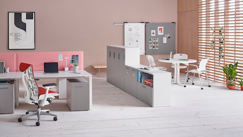 Tu storage components create a boundary between individual workstations and a collaboration zone.