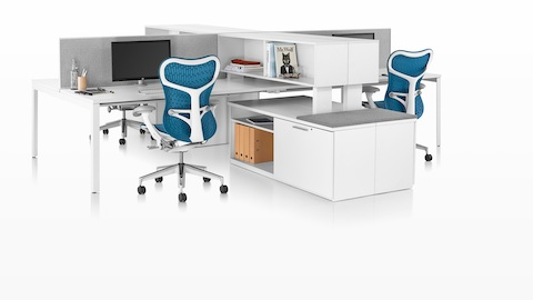 A Tu credenza with a cushion top provides guest seating for two adjacent workstations.