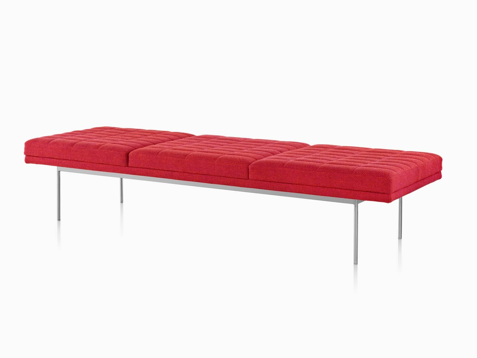 Red Tuxedo Bench with quilted upholstery bright chrome base, viewed from the front at an angle.