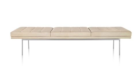 Tan Tuxedo Bench with quilted upholstery and bright chrome base, viewed from the front.