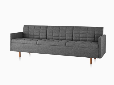 Dark gray Tuxedo Classic sofa with wood legs, viewed from the front on an angle.