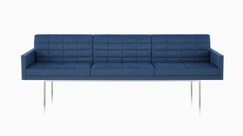 A three-seat Tuxedo Component Sofa with a metal base and quilted upholstery.