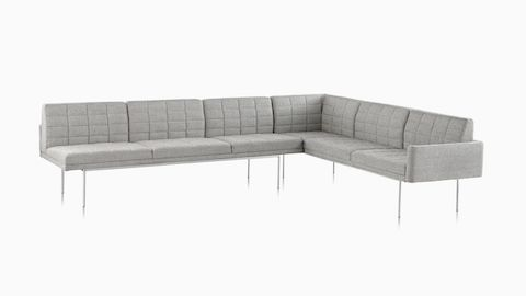 A Tuxedo Component Sofa corner unit with a metal base and quilted upholstery.