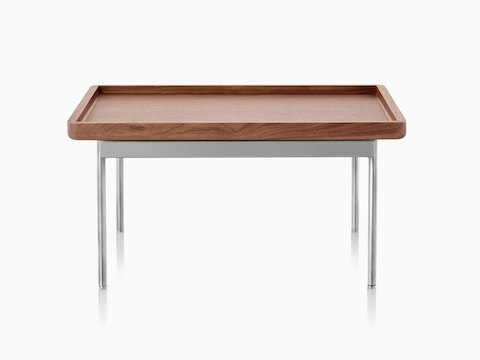 A rectangular Tuxedo Component Table with a wood top and metal base.