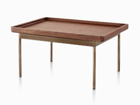 An angled view of a rectangular Tuxedo Table with a medium woodgrain finish and brown metal base.