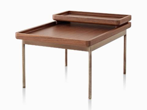 An angled view of a rectangular Tuxedo Table and nesting tray, both with a medium woodgrain finish.