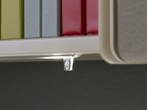 Close view of the illumination-control tab on a Twist LED Task Light.
