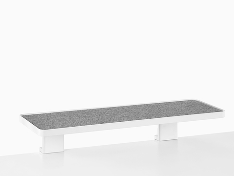 A low, long Ubi Attached Shelf.