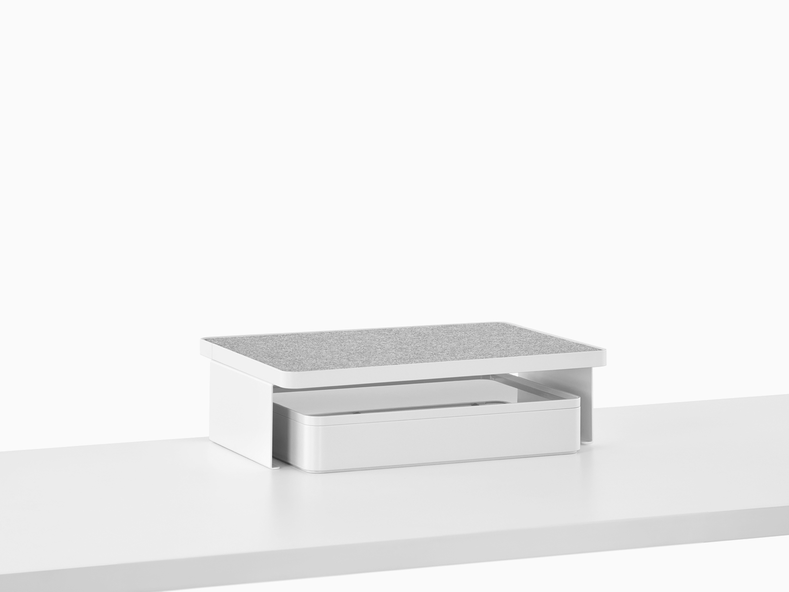 A Ubi Freestanding Shelf with a non-skid surface and a storage box below.