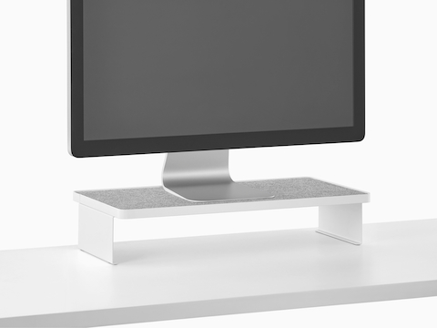 A freestanding monitor sits on a Ubi Monitor Platform Shelf.