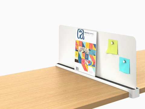 A Ubi Slim Screen props up a catalog and displays sticky notes with magnets.
