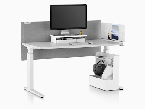 A rectangular sit-to-stand table equipped with Ubi Work Tools, including a monitor platform shelf and mobile bag catch.