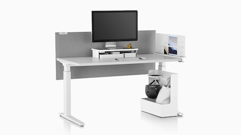 A rectangular sit-to-stand table equipped with Ubi Work Tools, including a Ubi Monitor Platform Shelf and Ubi Mobile Bag Catch.