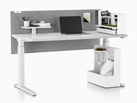A rectangular sit-to-stand table equipped with Ubi Work Tools, including a Ubi Mobile Bag Catch and desktop organizer.