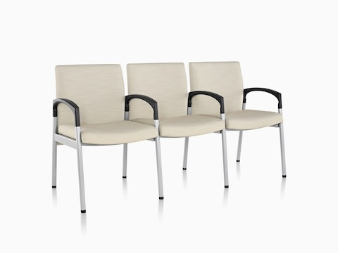 Three-seat Valor Multiple Seating with beige upholstery, a steel frame, and intervening black arms.