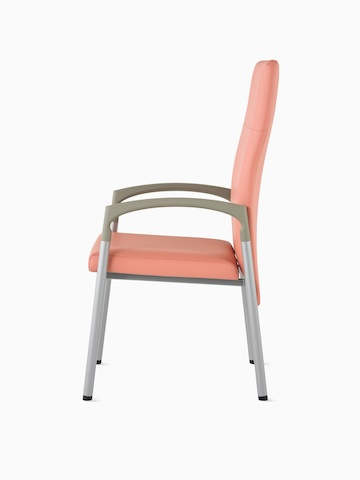 Side view of a high-back Valor Patient Chair in a salmon pink upholstery and silver frame with pewter armcaps.
