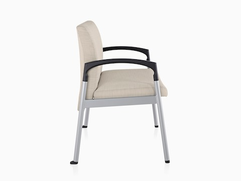 Profile view of beige Valor Plus Seating with a wide seat, steel frame, and black arms.